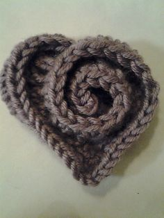 This would look cute on a baby hat    Ravelry: Project Gallery for rosy heart pattern by Mia's Heartful Hands