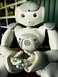 Aldebaran Robotics Nao robot sits idle for a brief moment at the Stanford Robot…