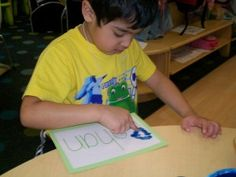 preschool literacy activity tracing letters with fingerprints