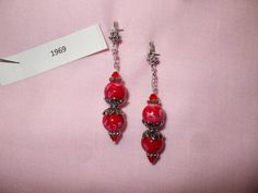 """round """"mottled"""" acrylic beads with silver bead caps, daisy spacers and red Swarovski crystals"""