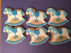Blue and white rocking horse cookies are so cute for a boy's baby shower.