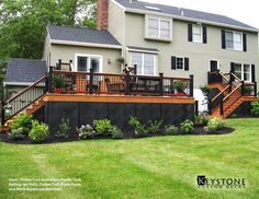 This Custom TimberTech Evolution Pacific Teak decking with Ipe Rails, TimberTech Black Posts, and Round Black Aluminum Balusters. This Deck also features Black Lattice around the bottom of the deck. Built by Keystone Custom Decks.