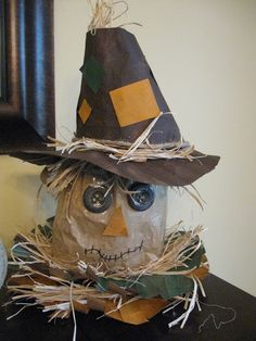 Thanksgiving or Fall Craft.  Scarecrow made out of mostly recycled materials.