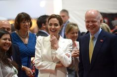 Pin for Later: Angie Gets Support From Brad and George's New Fiancée at Her Special Summit  Angelina walked with William Hague to visit with attendees and speakers at the summit on Wednesday.