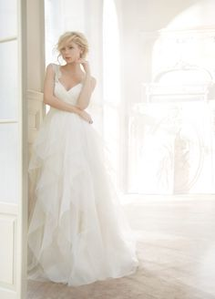 CarrieIvory english net A·line natural waist bridal gown with draped sweetheart bodice, tiered flounce skirt, crystal straps, keyhole back, and chapel train.