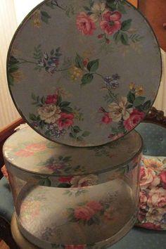 Vintage floral wallpaper hat boxes.