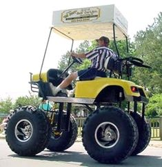 Big golf cart - probably got really deep rough at his golf course!
