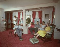 Walt, along with his daughters Diane and Sharon, wife Lilly, and a guest enjoy some quiet time at his private apartment on Main Street, U.S.A. (That guest is Walt's son-in-law. I'm not sure if it was official in this picture yet, though.) | 18 Wonderful And Rare Color Photos Of Disneyland In 1955