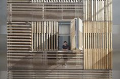 Luxury apartment building on Passatge Marimon in Barcelona by Mateoarquitectura #wood #wooden slats