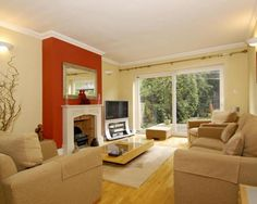 photo of orange russet terracotta rust living room lounge with curtain rail fireplace feature wall and furniture sofa