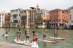 Group of active tourists stand up paddling on sup boards at Grand Canal Venice Italy. by kasto80