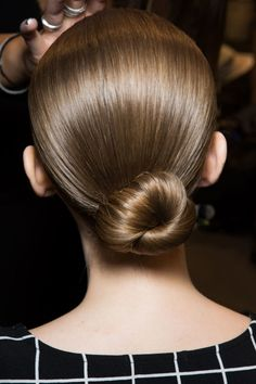 Hair: Sleek Bun - Never underestimate the power of polish, especially when time is of the essence. When in doubt, pull hair into a low, neat chignon. Low Bun Wedding Hair, Short Bridal Hair, 5 Minute Hairstyles, Bun Hairstyles For Long Hair, Dance Competition Hair, Medium Hair Styles, Curly Hair Styles, Hair Color For Women, Prom Hair