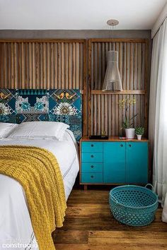 I dig the wooden slats behind the bed as a wall feature