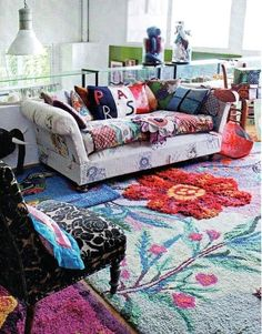 living space, large colorful rug, mix of colors, textures, mismatched boho via: thatbohemiangirl: