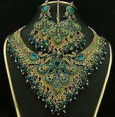 Some intricate beadwork I've seen on Pinterest has not turned my crank, but this is stunning in a peacock-goddess sort of way.