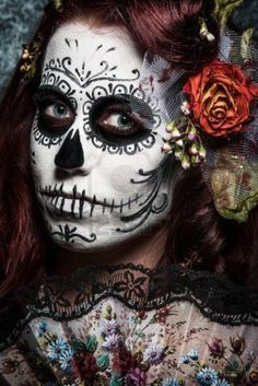 a woman with her face painted as a traditional day of the dead sugarskull mask Stock Photo - 12516821