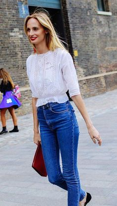 Lauren Santo Domingo in a white lace top and blue jeans