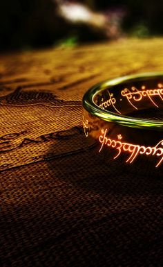 """One ring to rule them all, one ring to find them/ One ring to bring them all and in the darkness bind them"""