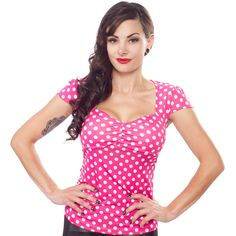 SOURPUSS VAVAVOOM TOP PNK/WHT POLKA DOTS Dress like the doll you are in the pinup perfect Vavavoom Top from Sourpuss! This pink & white polka dotted top accentuates while giving you a slimming look with it's ruched sweetheart neckline & adorable cap sleeves. $36.00