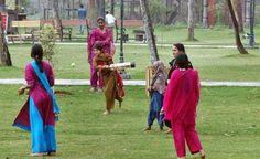 Women play cricket. Pakistan