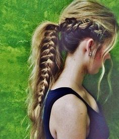Dutch braid into a long and messy pony tail.