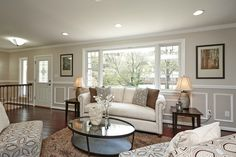 Transitional Living Room with Crown molding, Milgard Style Line Series Picture Window, Hardwood floors, flush light, Carpet