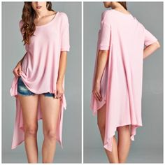 Oversized tunic high low hemline Pink and mint available nwot sizes S M L . Please comment for personal listing oversized thermal tunic with high Low hemline Assymetrical shark bite hemline . Vivacouture Tops