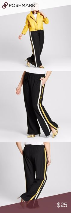 "Who What Wear Wide Leg Track Pants 3X Black The bold look that's amazing with everything from your trusty white sneakers to spicy stilettos: the Wide-Leg Track Pant - Who What Wear™. Raucous yellow and white stripes down the side add a mile to your legs, while the soft fabric makes them stealthily cozy and chic at the same time. A must with your favorite bomber or a luxe lacy top. Fit: Wide Leg Material: 100% Polyester, Pocket Style: Side pocket Care and Cleaning: machine wash Waist flat 25""…"