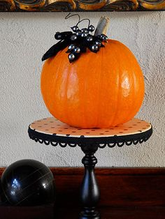 This pin was suppose to be about the pumpkin, but my eyes went right to the tiny table that the pumpkin is sitting on.  Round piece of wood, some scrapbook paper, trim for the edge & a large (painted) candle stick. Glue table top to candle stick - modge podge scrapbook paper & add trim. Very cute!
