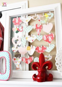 Valentine's Day Mantel Ideas - Love this framed collage of hearts cut from scrapbook paper. So simple and pretty!