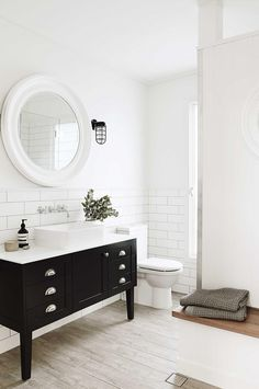 Vintage Beach Home In Black And White: black and white bathroom mirror toilet