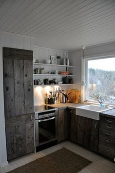 nice minimalist kitchen, but I love the modern range with a full oven. For mine I'd keep only the side with the shelves and move the sink over there too. For prep space I'd have fake island out of those wheeled kitchen cart/ butcher blocks from Ikea.