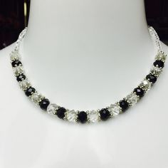 "Black & Clear Silvertone Beaded Necklace BEAUTIFUL! Black & Clear Beaded Necklace with Silver Tone Spacers, Measures 18"" in Length with a 2"" Extender.  Lobster Claw Closure. RETAILS $45.00 Unknown  Jewelry Necklaces"