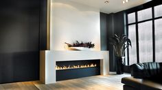this modern gas fires gives a nod to the more traditional fireplace shape. Clean, sleek lines and an integrated linefire (ribbon fire) give make this modern gas fires a bold and striking feature. With different burner size options – the largest being 2.4m long – as well as other bespoke options, this fireplace is ideal for both large and more intimate spaces. Fully operated with a remote control this modern gas fire is ideal for our luxury 21st living…
