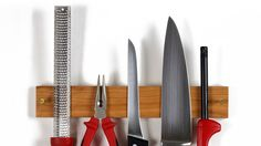 Easy Clean Knife Grabbers - magnets keep the knives attached can mount it or put it in a drawer.