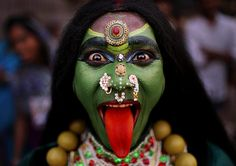 An Indian man dressed as Hindu Goddess Kali participates in a religious procession to mark Ram Navami festival in New Delhi, India. Ram Navami celebrates the birthday of Hindu god Rama. Cultures Du Monde, World Cultures, We Are The World, People Of The World, Fotojournalismus, Kali Ma, Arte Tribal, Tribal Art, Photo Libre