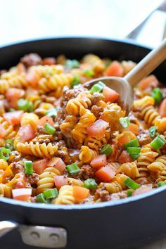 One Pot Cheeseburger Casserole - This cheesy goodness comes together so easily in one skillet. Even the pasta gets cooked right in the pan! Use SF ingredients.