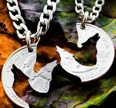 A pair of interlocking silver coin necklaces with hand-cut howling wolves — to let the world know you and your bestie are nothing to play with.