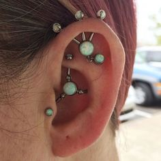 Body piercing jewellery - unique conjoined ear piercing - tragus - rook - conch - triple forward helix - cartilage