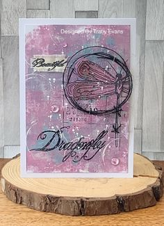 """Today I am showcasing a mixed media card using my newly released """"On Dragonfly Wings"""" from AALLandCreate ."""