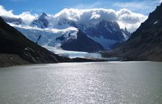 Glaciar Torres and Lago Torres, El Chalten, Argentina in Patagonia. -   Why?   The hike is fantastic because of the views of the peaks of Cerro Torre and Fitz Roy all along the trail.  How?  Every bus coming into town in El Chalten stops at the ranger station for a short introduction to the area and a presentation of all the available trekking, climbing, and camping opportunities.  When?  Summer (December-February) is the best time to visit El Chalten and most of Patagonia.