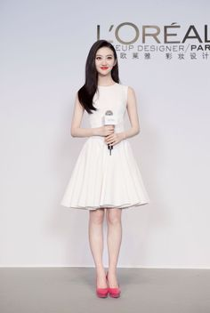 "Chinese actress Jing Tian was lovely in GEORGES HOBEIKA for her introduction as the newest member of L'Oreal's ""Dream Team"" and the company's official brand ambassador for Asia. Tian donned a white crepe, sleeveless cocktail dress featuring a fitted waist and a flowing skater skirt from Georges Hobeika's SS 2015 Signature collection. #GeorgesHobeika #PFW #fashionweek #signature #SS15 #spring #summer #JingTian #readytowear #RTW #LOREAL #actress #celebrity #china #fashion #paris"