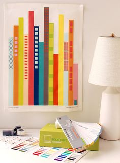 Cityscape tea towel...looks like book spines. Love the colors. Might look cool framed.