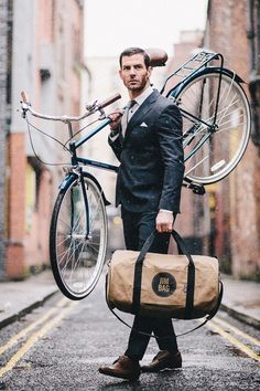 Environmentally conscious suited wearing bag carrying gentleman.
