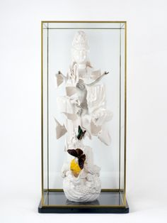 Goddess of compassion, 2010. 19th century Chinese porcelain figure of Guan Yin, continental bisque crucifix and mixed media. 300 x 300 x 690 mm. Collection van Dam, The Netherlands.