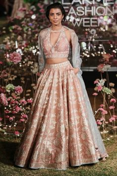 Dressed in motifs of wildflowers and vines from summer forests, the onion pink Sahira Lehenga is perfect for a summer wedding. This foil printed lehenga is paired with an embroidered choli and organza dupatta. Style Tip: Team this lehenga with state Luxury Wedding Dress, Backless Wedding, Elegant Wedding Dress, Lace Wedding, Bride Reception Dresses, Bridal Dresses, Wedding Reception, Desi Wedding, Gothic Wedding
