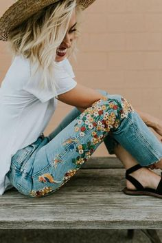 The embroidery trend and how to wear it, embroidered flower jeans with small all over daizies