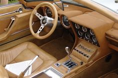 Brown hides wherever you look inside the Lamborghini Miura Roadster Zn75 edition, note the glossy metal everywhere