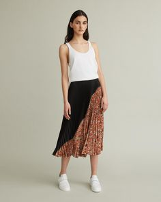 Asymmetric seam pleated midi skirt with floral panel. Sits at waist Invisible side zip Asymmetrical seam Midi length Knife pleated polyester Model is 178 cm/ ft and is wearing a size 38 Floral Pleated Skirt, Retail Concepts, Cool Suits, Apothecary, Designing Women, Skirts, Model, How To Wear, Skirt