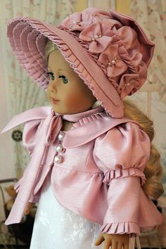 Caroline is modeling her fancy new Spencer jacket and bonnet. It is made in a dusty pink shantung satin. The jacket is fully lined in the same satin